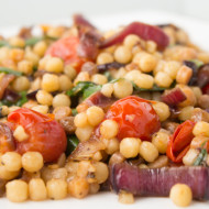 Fregula with charred onions and cherry tomatoes